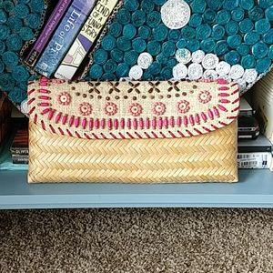 Oversized woven & beaded clutch